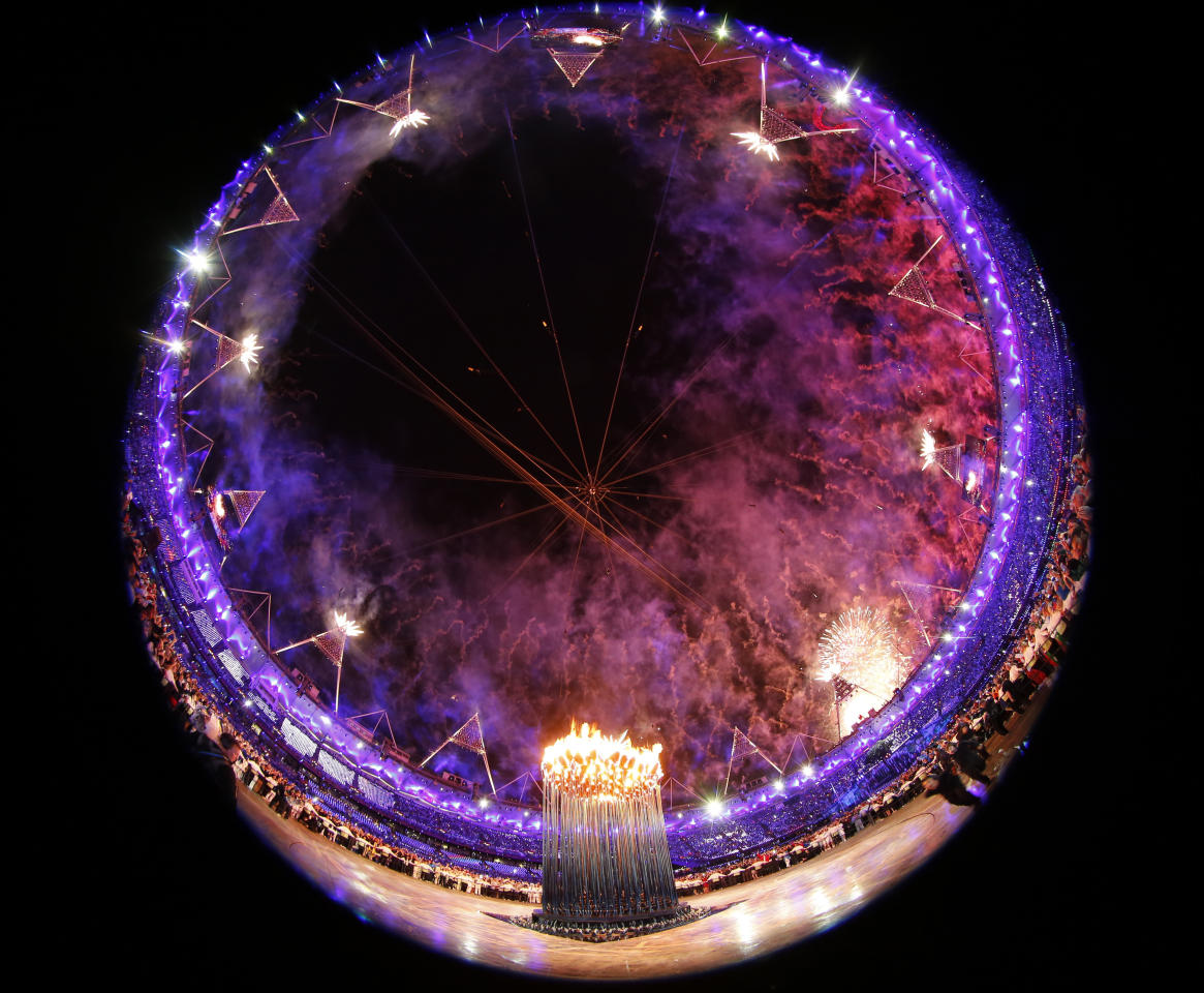 Fireworks explode after the Olympic cauldron was lit during the opening ceremony of the London 2012 Olympic Games at the Olympic Stadium July 27, 2012.    REUTERS/Kai Pfaffenbach (BRITAIN  - Tags: SPORT OLYMPICS TPX IMAGES OF THE DAY)