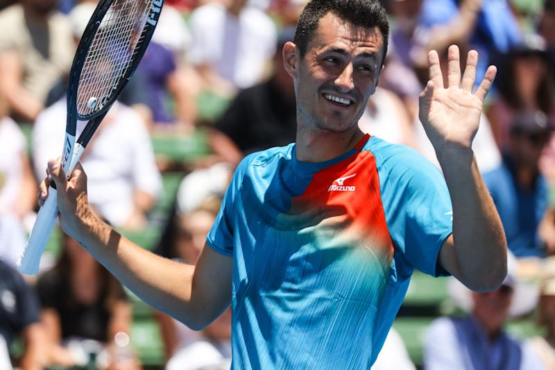 MELBOURNE, AUSTRALIA - JANUARY 9: Bernard Tomic (AUS) smiles at Nick Kyrgios (AUS) during his match against at the 2019 Kooyong Classic (Photo credit should read Chris Putnam / Barcroft Media via Getty Images)