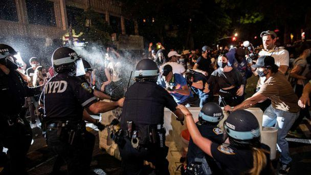 PHOTO: A police officer sprays protesters during a march against the death in Minneapolis police custody of George Floyd, in Brooklyn, New York, May 30, 2020. (Jeenah Moon/Reuters)