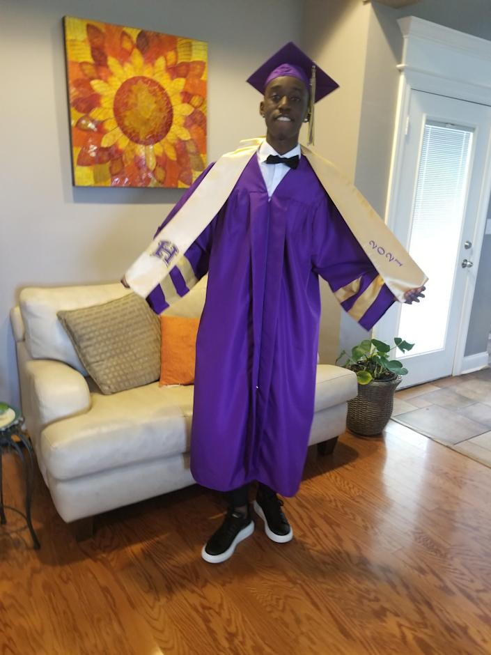 Daverius Peters wearing the black sneakers he tried to wear to his graduation ceremony. / Credit: Courtesy of Jima Smith