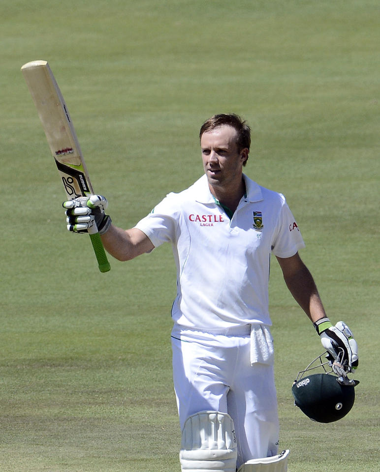 South African batsman AB de Villiers raises his bat to celebrate his century during the second day of the third Test match between South Africa and Pakistan on February 23, 2013 at Super Sport Park in Centurion. AFP PHOTO / STEPHANE DE SAKUTIN        (Photo credit should read STEPHANE DE SAKUTIN/AFP/Getty Images)