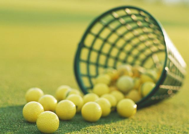 "<h1 class=""title"">Spilled basket of yellow golf balls, close-up</h1> <div class=""caption""> Spilled basket of yellow golf balls, close-up </div> <cite class=""credit"">Laurence Mouton</cite>"
