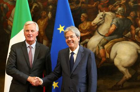 European Union's chief Brexit negotiator Michel Barnier (L) shakes hand with Italy's Prime Minister Paolo Gentiloni during a meeting in Rome, Italy September 21, 2017.    REUTERS/Alessandro Bianchi