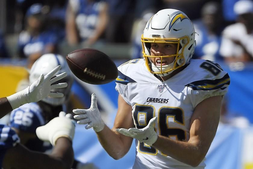 FILE- In this Sunday, Sept. 8, 2019, file photo, Los Angeles Chargers tight end Hunter Henry, right, makes a catch during the second half of an NFL football game against the Indianapolis Colts in Carson, Calif. Henry will be placed on injured reserve because of a knee injury. He fractured the upper part of his left tibia during Sunday's 30-24 overtime win over the Colts. (AP Photo/Mark J. Terrill, File)