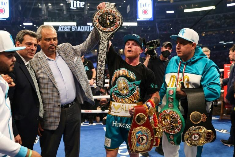 """One title to go: Saul """"Canelo"""" Alvarez shows off his championship belts after defeating Billy Joe Saunders during their super middleweight unification fight"""