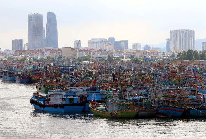 Fishing boats are seen at a port after returning to avoid Molave typhoon in Da Nang city