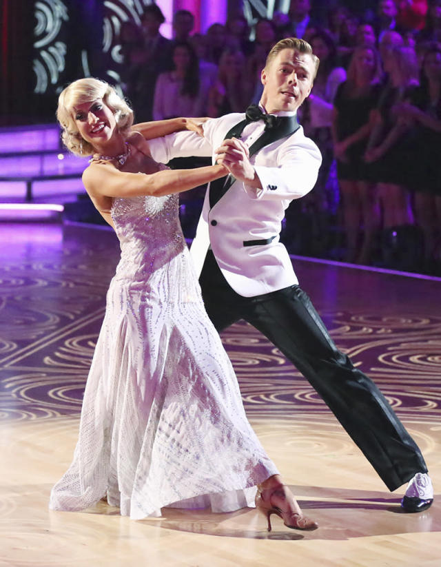 "In Week 5, Kellie and Derek's foxtrot featured old Hollywood glam, as the country star sported a bobbed blond wig and a sparkly evening gown. Kellie told <a href=""https://ec.yimg.com/ec?url=http%3a%2f%2fwww.theboot.com%2f2013%2f04%2f16%2fkellie-pickler-dancing-with-the-stars-week-5-foxtrot%2f%26quot%3b&t=1524234440&sig=iNh4hX40I8HnjCgxpDyRWw--~D rel=""nofollow noopener"" target=""_blank"" data-ylk=""slk:the Boot"" class=""link rapid-noclick-resp"">the Boot</a> she loved the ""custom-made, couture, beautiful outfits"" she wore on the show. ""The wardrobe team here is unbelievable, and they make everything by hand,"" she said, noting her Hollywood starlet ensemble. ""This is the most clothes they've given me all season!"""