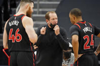 Toronto Raptors head coach Nick Nurse talks to center Aron Baynes (46) and guard Norman Powell (24) during the second half of an NBA basketball game against the Philadelphia 76ers Sunday, Feb. 21, 2021, in Tampa, Fla. (AP Photo/Chris O'Meara)