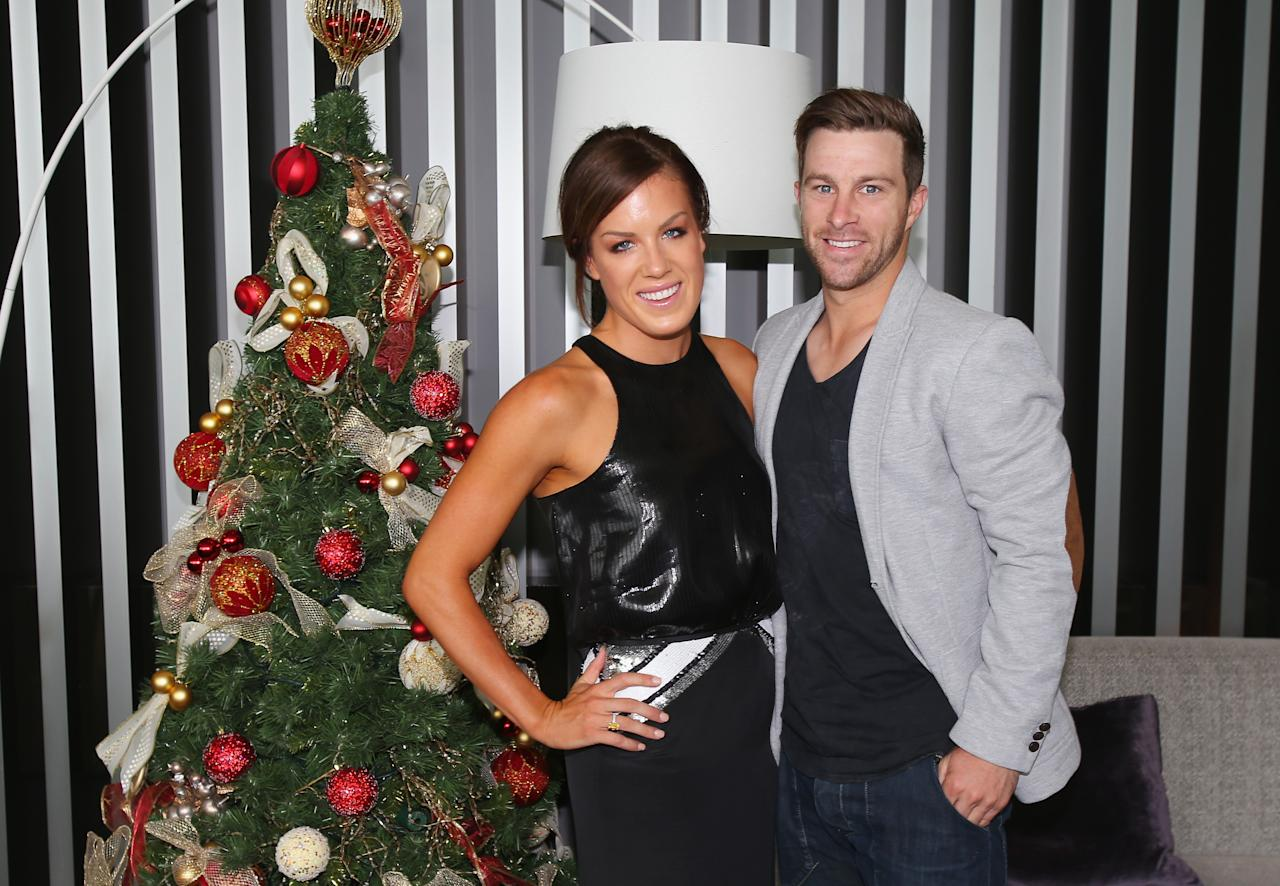 MELBOURNE, AUSTRALIA - DECEMBER 25:  Matthew Wade and Julia Barry pose next to a Christmas tree ahead of a Cricket Australia Christmas Day lunch at Crown Entertainment Complex on December 25, 2012 in Melbourne, Australia.  (Photo by Scott Barbour/Getty Images)