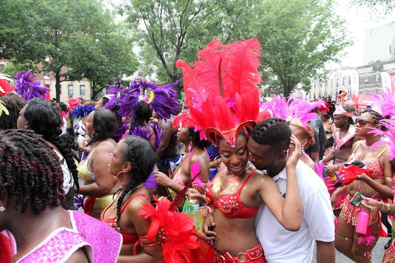 Parade participants make their way along Eastern Parkway in the Brooklyn borough of New York during the West Indian Day Parade Monday, Sept. 2, 2013. (AP Photo/Tina Fineberg)