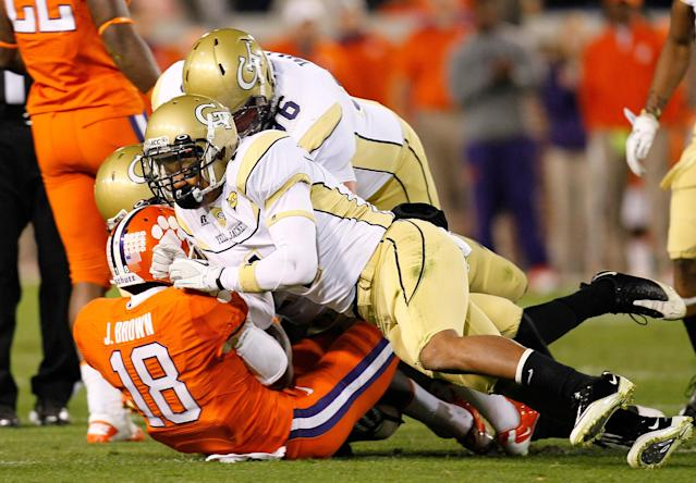 ATLANTA, GA - OCTOBER 29: Jaron Brown #18 of the Clemson Tigers is tackled by Jeremiah Attaochu #45, Isaiah Johnson #1 and Logan Walls #96 of the Georgia Tech Yellow Jackets at Bobby Dodd Stadium on October 29, 2011 in Atlanta, Georgia. (Photo by Kevin C. Cox/Getty Images)