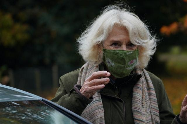 Camilla wore a face mas wen she first arrived at the event. Arthur Edwards/The Sun