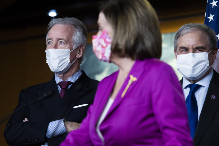 UNITED STATES - MARCH 09: Rep. Richard Neal, D-Mass., left, chairman of the Way and Means Committee, Rep. John Yarmuth, D-Ky., chairman of the House Budget Committee, and Speaker of the House Nancy Pelosi, D-Calif., conduct a news conference on the coronavirus relief bill, the American Rescue Plan Act, in the Capitol Visitor Center on Tuesday, March 9, 2021. (Photo By Tom Williams/CQ-Roll Call, Inc via Getty Images)
