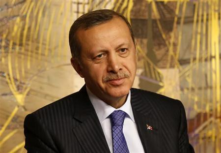 Turkey's Prime Minister Erdogan is seen during a joint news conference with his Libyan counterpart Zeidan in Istanbul