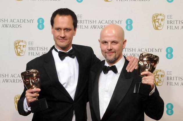 Diarmid Scrimshaw and Peter Carlton, winners of the Short Film award for 'Swimmer', pose in the press room at the EE British Academy Film Awards at The Royal Opera House on February 10, 2013 in London, England. (Photo by Stuart Wilson/Getty Images)