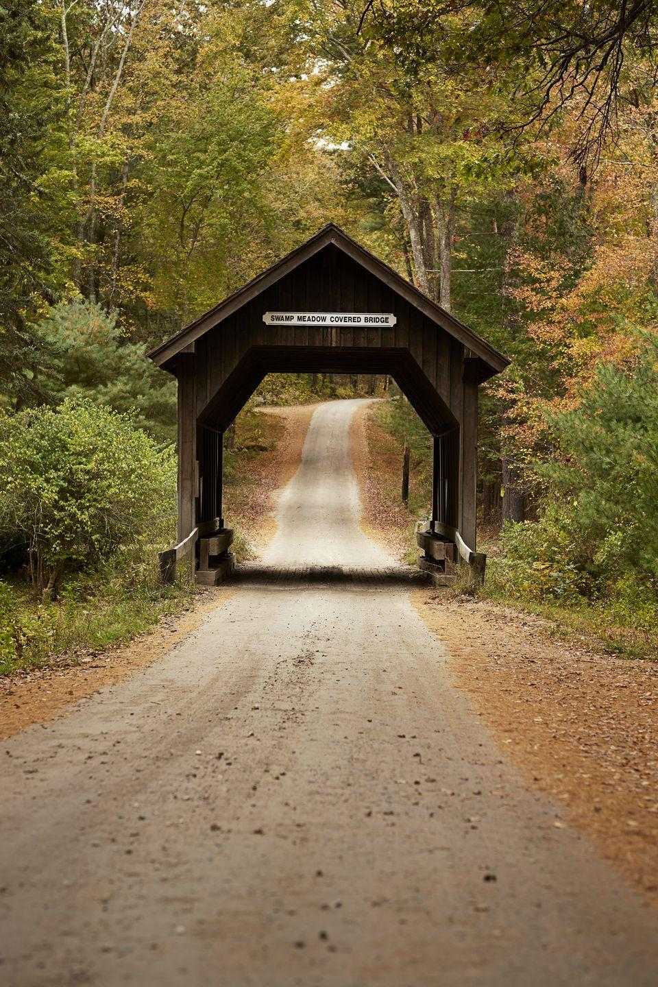 """<p>The northern town of Foster is said to be cursed by a vengeful woman, Dolly Cole, who lived in the area in the 1800s. It's rumored that she was <a href=""""https://www.onlyinyourstate.com/rhode-island/urban-legends-ri/"""" rel=""""nofollow noopener"""" target=""""_blank"""" data-ylk=""""slk:accused of witchcraft"""" class=""""link rapid-noclick-resp"""">accused of witchcraft</a>, so the townies set her home ablaze. She wasn't home at the time, however, her daughter was, and she tragically died in the fire. At the bereavement of her daughter, Cole placed a curse on the town, and sightings of her spirit are reported all over town.</p>"""