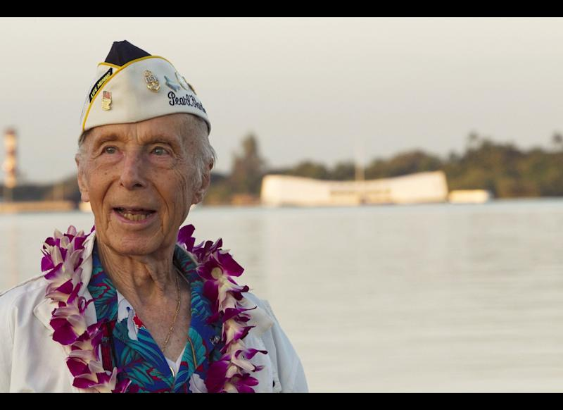 With the USS Arizona memorial in the background, Pearl Harbor survivor Richard Laubert, of Phoenix, Ore., attends the 69th anniversary ceremony marking the attack.