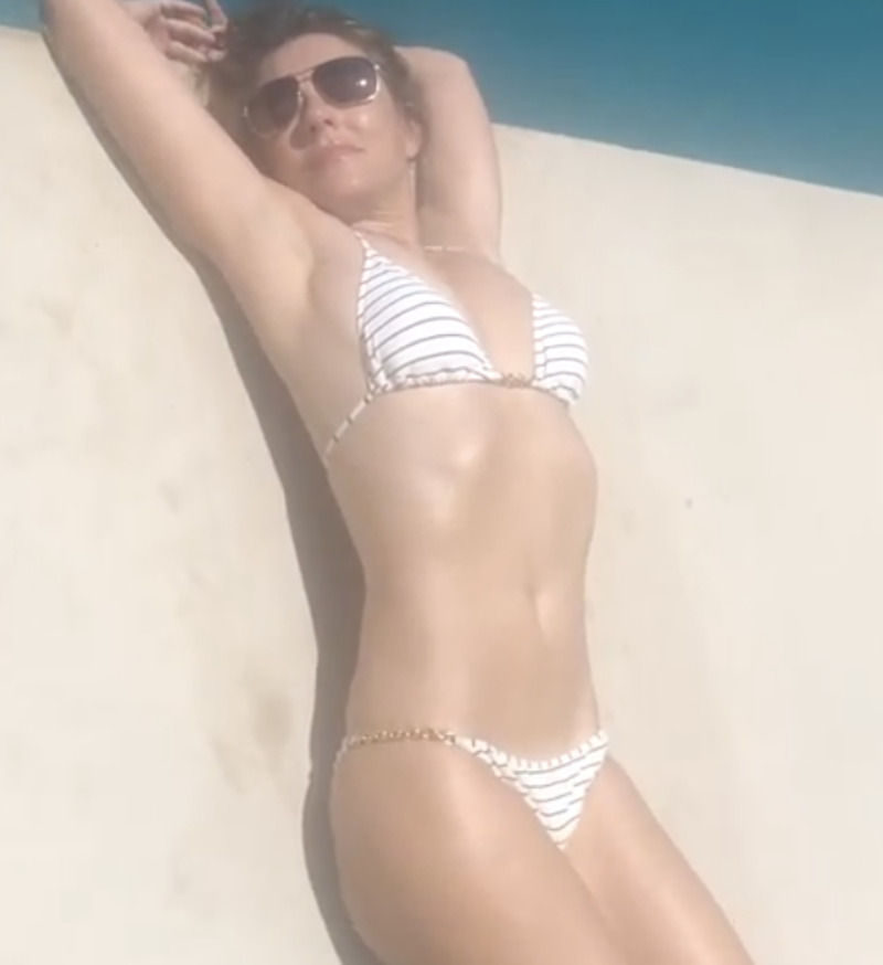 Elizabeth Hurley posed in a striped bikini by the pool. (Photo: Instagram)