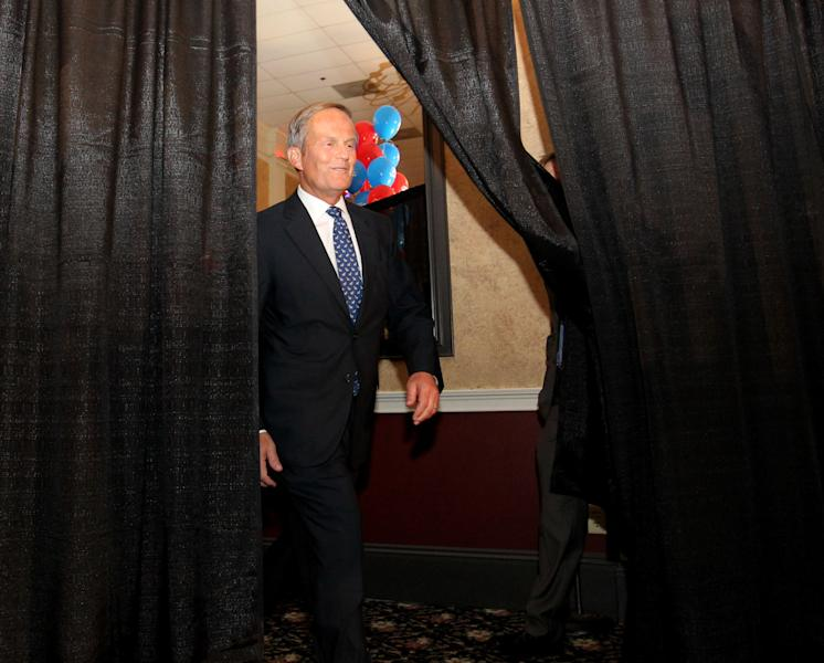 Republican U.S. Senate candidate Todd Akin emerges to give his victory speech after his win in the senate primary race at his campaign party at the Columns Banquet Center in St. Charles, Mo., on Tuesday, Aug. 7, 2012. (AP Photo/St. Louis Post-Dispatch, Christian Gooden) EDWARDSVILLE INTELLIGENCER OUT; THE ALTON TELEGRAPH OUT