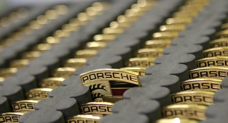 Car emblems for new Porsche 918-Spyder are placed in box at production line of German car manufacturer's plant in Stuttgart