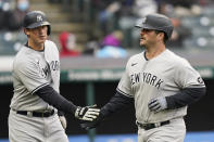 New York Yankees' DJ LeMahieu, left, and Mike Ford celebrate as they score in the third inning of a baseball game against the Cleveland Indians, Thursday, April 22, 2021, in Cleveland. (AP Photo/Tony Dejak)