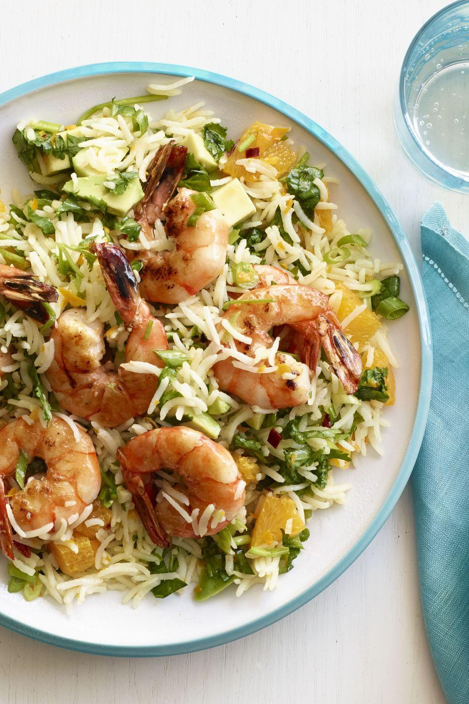 """<p>If she loves seafood, get to work whipping up this simple but impressive meal packed with fresh produce and a touch of spice.</p><p><em><a href=""""https://www.womansday.com/food-recipes/food-drinks/recipes/a13080/zesty-shrimp-chimichurri-rice-recipe-wdy0115/"""" rel=""""nofollow noopener"""" target=""""_blank"""" data-ylk=""""slk:Get the recipe for Zesty Shrimp with Chimichurri Rice."""" class=""""link rapid-noclick-resp"""">Get the recipe for Zesty Shrimp with Chimichurri Rice.</a></em></p><p><strong>RELATED:</strong> <a href=""""https://www.womansday.com/food-recipes/g2237/brunch-recipes/"""" rel=""""nofollow noopener"""" target=""""_blank"""" data-ylk=""""slk:40 Brunch Recipes for a Picture-Perfect Mother's Day Celebration"""" class=""""link rapid-noclick-resp"""">40 Brunch Recipes for a Picture-Perfect Mother's Day Celebration</a></p>"""
