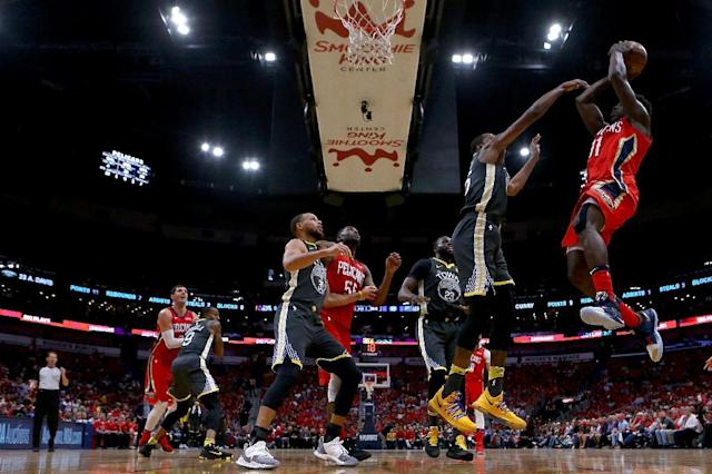 Jrue Holiday of the New Orleans Pelicans shoots over Kevin Durant of the Golden State Warriors as the Pelicans narrowed the gap in their playoff series to 2-1 with a 119-100 win (AFP Photo/Sean Gardner)