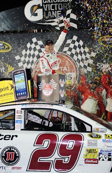 Kevin Harvick celebrates winning the Toyota Owner's 400 NASCAR Sprint Cup series auto race at Richmond International Raceway in Richmond, Va., Saturday April 27, 2013. (AP Photo/Clem Britt)