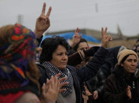 A woman gestures during a protest near the Syrian-Turkish border in Ras al-Ayn town, Syria December 20, 2018. REUTERS/Rodi Said