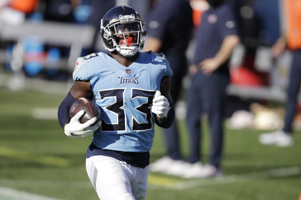 Tennessee Titans cornerback Desmond King (33) looks up a the scoreboard video screen as he returns a fumble recovery 63 yards for a touchdown against the Chicago Bears in the second half of an NFL football game Sunday, Nov. 8, 2020, in Nashville, Tenn. (AP Photo/Ben Margot)