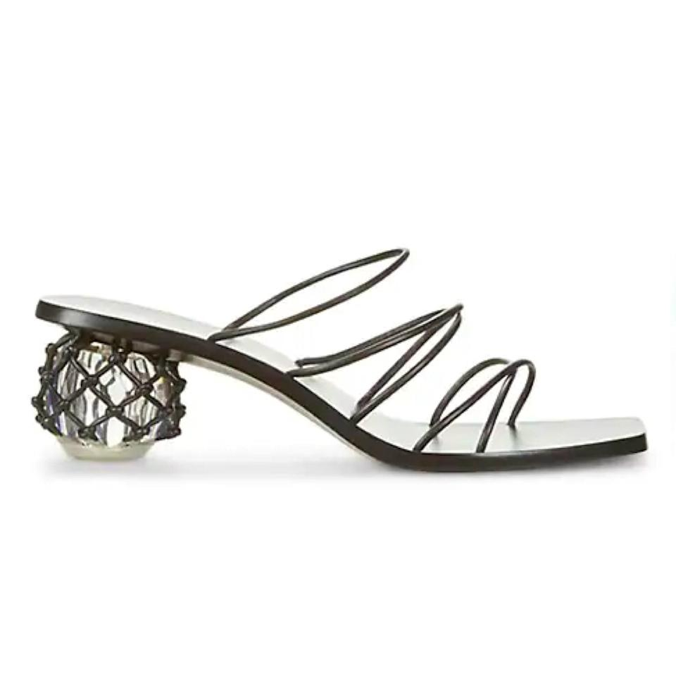 """A cheeky nod to fishnet, this knotted style would be the perfect for a seaside wedding, while the low bauble heel provides adequate support. $398, Saks Fifth Avenue. <a href=""""https://www.saksfifthavenue.com/product/cult-gaia-kelly-bauble-heel-leather-mules-0400013620583.html?"""" rel=""""nofollow noopener"""" target=""""_blank"""" data-ylk=""""slk:Get it now!"""" class=""""link rapid-noclick-resp"""">Get it now!</a>"""