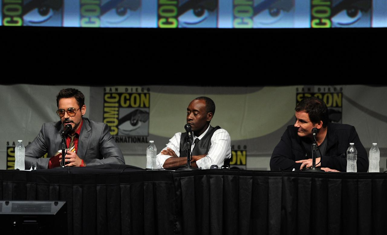 """SAN DIEGO, CA - JULY 14:  (L-R) Actors Robert Downey Jr., Don Cheadle, and director Shane Black speak at Marvel Studios """"Iron Man 3"""" panel during Comic-Con International 2012 at San Diego Convention Center on July 14, 2012 in San Diego, California.  (Photo by Kevin Winter/Getty Images)"""