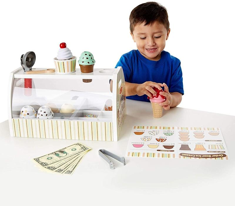 """If your kiddo <i>loves</i> ice cream, you might get them <a href=""""https://amzn.to/3hRan4Y"""" target=""""_blank"""" rel=""""noopener noreferrer"""">their very own play parlor</a>. Thisice cream station includes things likea scooper, scoops, cones and fake money. They'll definitely be entertained. <a href=""""https://amzn.to/3hRan4Y"""" target=""""_blank"""" rel=""""noopener noreferrer"""">Find it for $43 at Amazon</a>."""