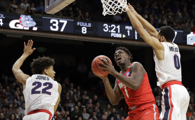 Ohio State forward Jae'Sean Tate (1) tries to shoot between Gonzaga forward Jeremy Jones (22) and guard Silas Melson, right, during the first half of a second-round game in the NCAA men's college basketball tournament Saturday, March 17, 2018, in Boise, Idaho. (AP Photo/Otto Kitsinger)