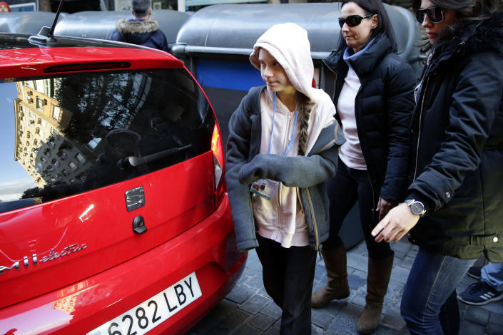 Climate activist Greta Thunberg arrives for a press conference in Madrid, Friday Dec. 6, 2019. Thunberg arrived in Madrid Friday to join thousands of other young people in a march to demand world leaders take real action against climate change. (AP Photo/Andrea Comas)