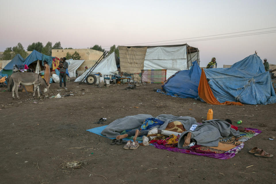 Tigray refugees who fled the conflict in the Ethiopia's Tigray sleep at Hamdeyat Transition Center near the Sudan-Ethiopia border, eastern Sudan, Thursday, Dec. 3, 2020. Ethiopian forces on Thursday blocked people from the country's embattled Tigray region from crossing into Sudan at the busiest crossing point for refugees, Sudanese forces said.(AP Photo/Nariman El-Mofty)