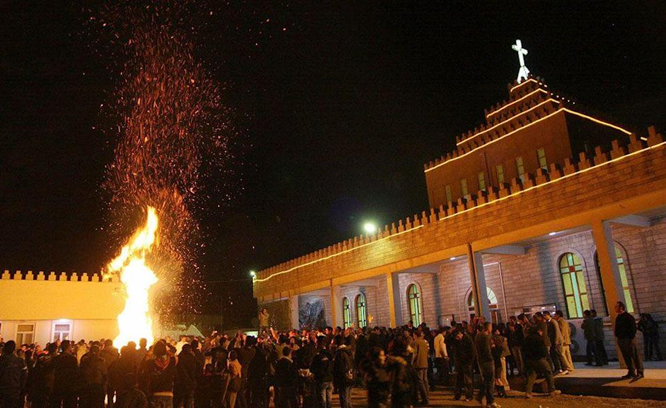 """<p>Christmas has only been an official holiday in Iraq since 2008. Christians gather at their local church and pray next to a large bonfire. The service ends with the Bishop blessing the congregation and touching one of the congregants. The congregant touches someone next to them and the process continues until every attendee has gotten the """"Touch of Peace.""""</p>"""