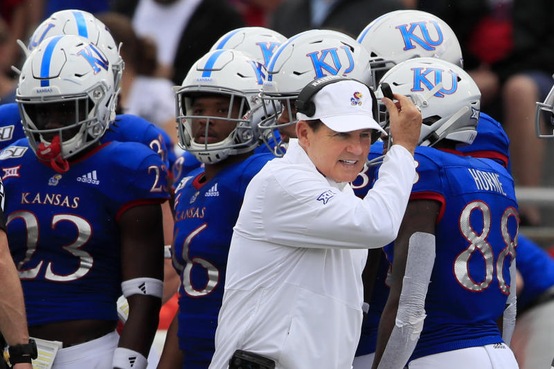 Kansas head coach Les Miles works the sidelines during the first half of an NCAA college football game against West Virginia in Lawrence, Kan., Saturday, Sept. 21, 2019. (AP Photo/Orlin Wagner)