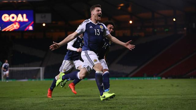 The pressure on Gordon Strachan has eased slightly after Chris Martin's late winner gave Scotland a 1-0 triumph over Slovenia.