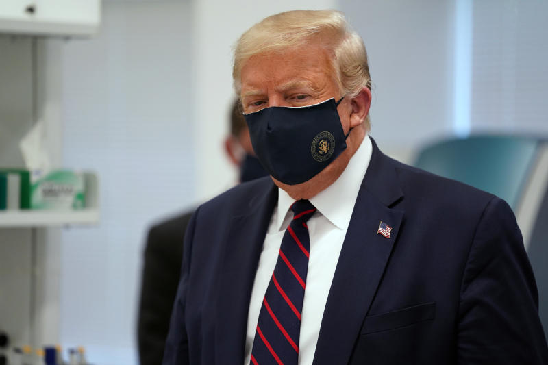 FILE - In this Monday, July 27, 2020 file photo, President Donald Trump wears a face mask as he participates in a tour at Fujifilm Diosynth Biotechnologies in Morrisville, N.C. On Friday, July 31, 2020, The Associated Press reported on stories circulating online incorrectly asserting Project Veritas captures Trump on video bashing his supporters. A parody account created and released the video, not Project Veritas, a conservative group known for using undercover tactics to reveal supposed liberal bias in the media. (AP Photo/Evan Vucci)