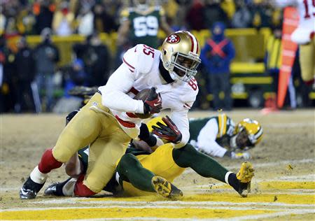Jan 5, 2014; Green Bay, WI, USA; San Francisco 49ers tight end Vernon Davis (85) makes a touchdown catch against Green Bay Packers strong safety Morgan Burnett (42) and inside linebacker A.J. Hawk (50)during the second haf of the 2013 NFC wild card playoff football game at Lambeau Field. Mandatory Credit: Mike DiNovo-USA TODAY Sports