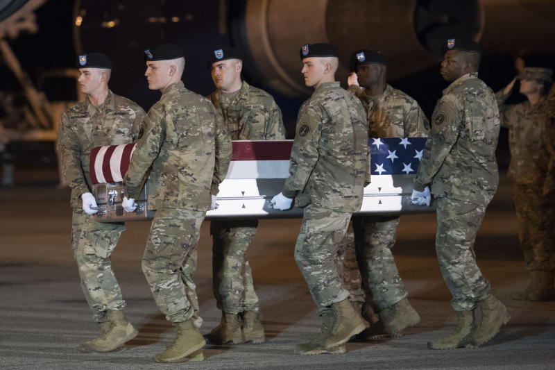 Soldiers carry the remains of Sgt. 1st Class Elis Barreto Ortiz, 34, on Sept. 7, 2019, at Dover Air Force Base, Del. Sgt. Ortiz was killed by an IED near Kabul, Afghanistan two days earlier. (Cliff Owen/AP Photo)