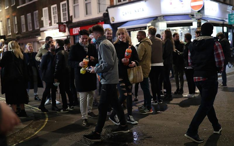 People in Soho, London, after pubs and restaurants were subject to a 10pm curfew to combat the rise in coronavirus cases in England. PA Photo. Picture date: Saturday September 26, 2020. - Yui Mok/PA Wire