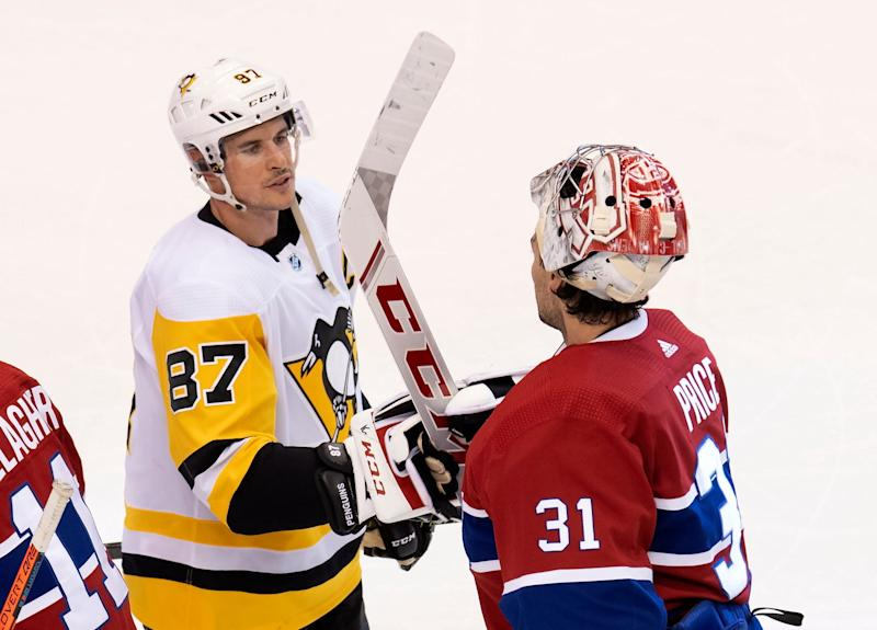 Pittsburgh Penguins center Sidney Crosby congratulates Montreal Canadiens goaltender Carey Price after Game 4.
