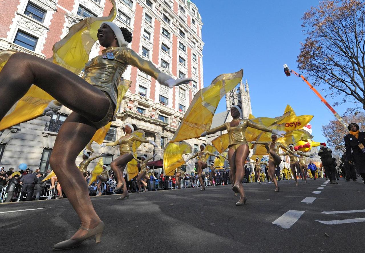 Dancers fill the street as the 86th annual Macy's Thanksgiving Day Parade moves down New York's Central Park West Thursday, Nov 22, 2012. (AP Photo/ Louis Lanzano)