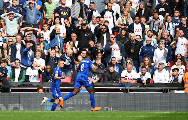 "Soccer Football - Premier League - Tottenham Hotspur vs Leicester City - Wembley Stadium, London, Britain - May 13, 2018 Leicester City's Jamie Vardy celebrates scoring their fourth goal with Kelechi Iheanacho REUTERS/Dylan Martinez EDITORIAL USE ONLY. No use with unauthorized audio, video, data, fixture lists, club/league logos or ""live"" services. Online in-match use limited to 75 images, no video emulation. No use in betting, games or single club/league/player publications. Please contact your account representative for further details."