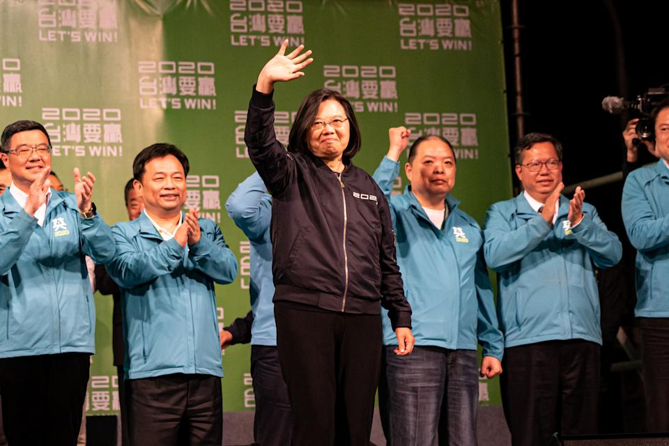 President Tsai Ing-Wen (C) and the DPP (Progressive Democratic Party) team in front of their supporters after the speech delivered following Tsai's victory and re-election as President of Taiwan. January 11, 2020. (Photo by Yat Kai Yeung/NurPhoto via Getty Images)
