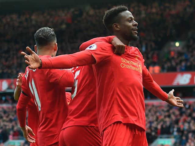 Divock Origi celebrates scoring Liverpool's third goal of the afternoon: Getty