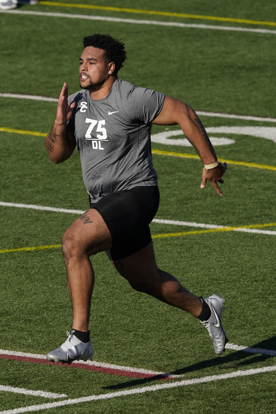 FILE - Southern California lineman Alijah Vera-Tucker participates in the school's pro day football workout for NFL scouts in Los Angeles, in this Wednesday, March 24, 2021, file photo. The Las Vegas Raiders spent the free agency period dismantling their offensive line and mostly ignoring the secondary. Now heading into the NFL draft, those are the two spots that appear to be the most urgent needs for the Raiders to fill starting with pick No. 17 in the first round. (AP Photo/Marcio Jose Sanchez, File)