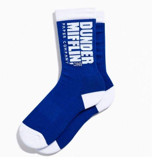 """Everyone loves socks. Everyone loves """"The Office."""" Everyone needs socks. Buy everyone socks! But them <a href=""""https://www.urbanoutfitters.com/en-ca/shop/the-office-sport-crew-sock"""" target=""""_blank"""" rel=""""noopener noreferrer"""">at Urban Outfitters</a>, 3 for $24."""